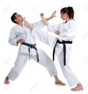 10217509-Karate-Young-girl-and-a-men-in-a-kimono-with-a-white-background-Battle-sports-capture-Stock-Photo